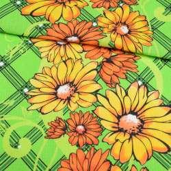 Тканина рушникова вафельна набивна салатова з жовто-помаранчевими квітами, ш.40